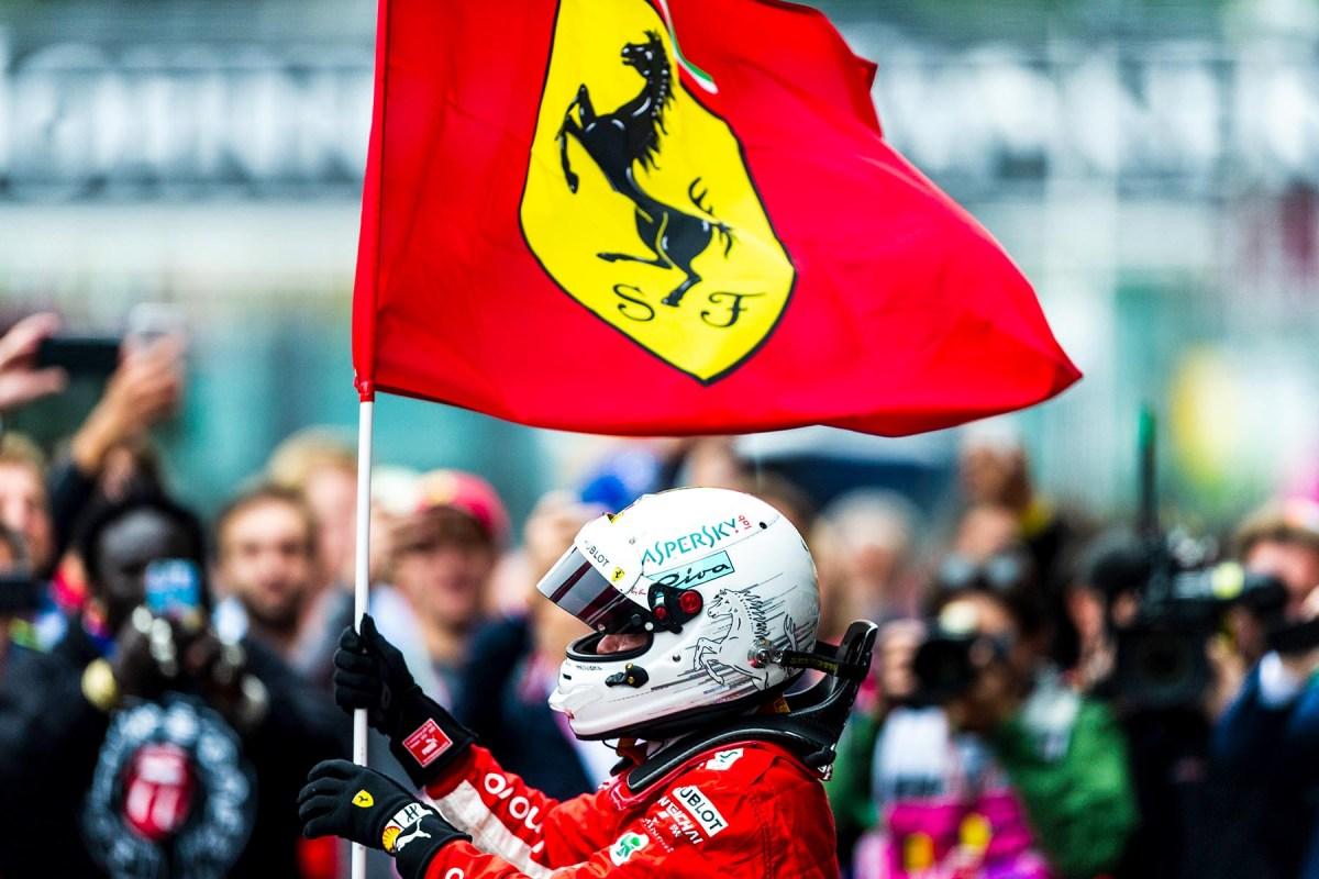 Sebastian Vettel waives the Ferrari flag at the 2018 Belgian Grand Prix.