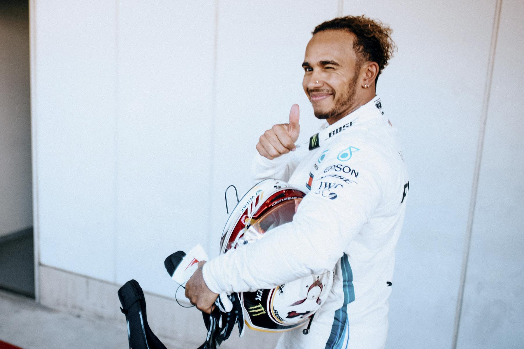 Lewis Hamilton celebrates victory at the 2018 Japanese Grand Prix.