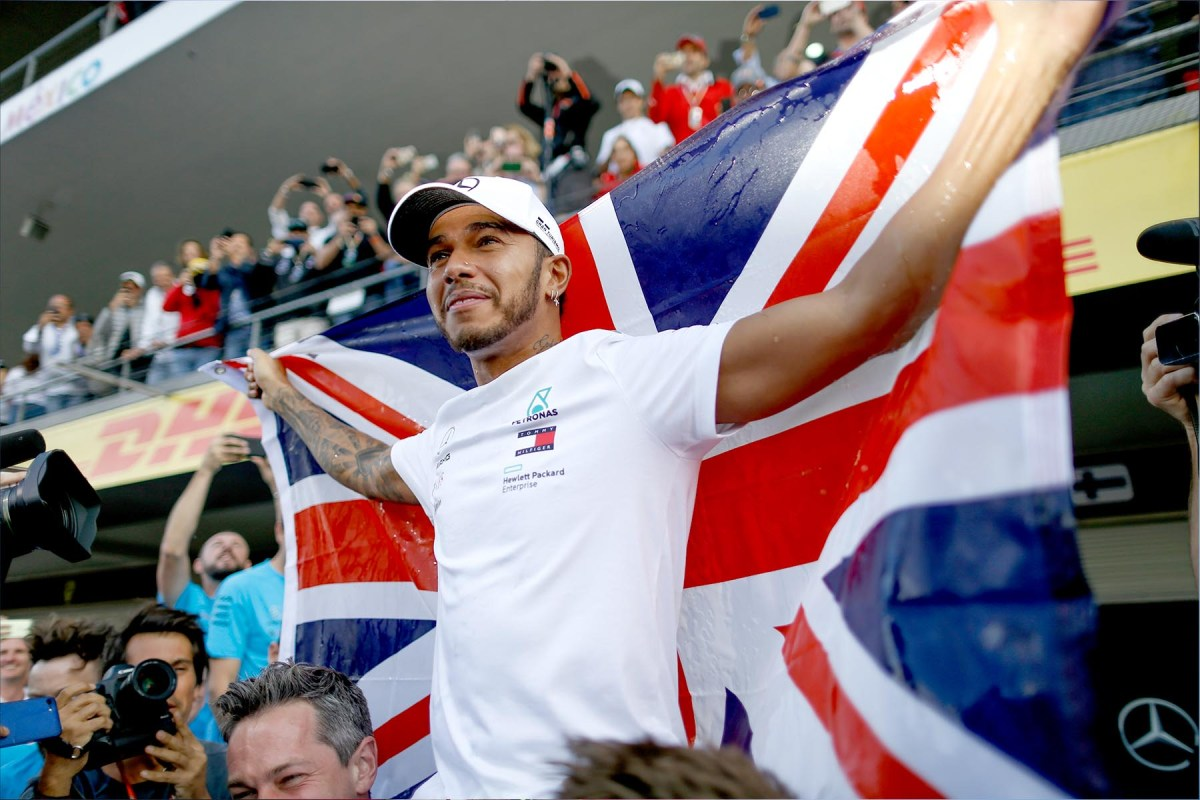 Lewis Hamilton celebrates in Mexico after winning the 2018 world championship.