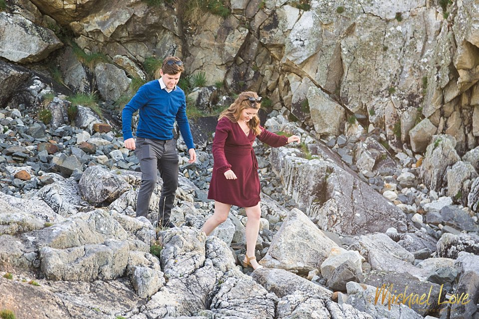 Couple walking over some rocks