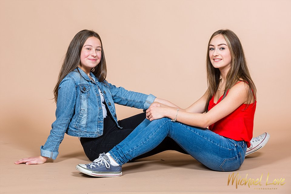 Portrait of two sisters in studio in Londonderry