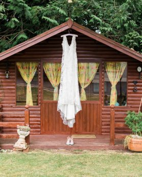 Wedding dress hanging outside