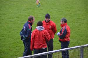 Management discussing tactics before throw-in.