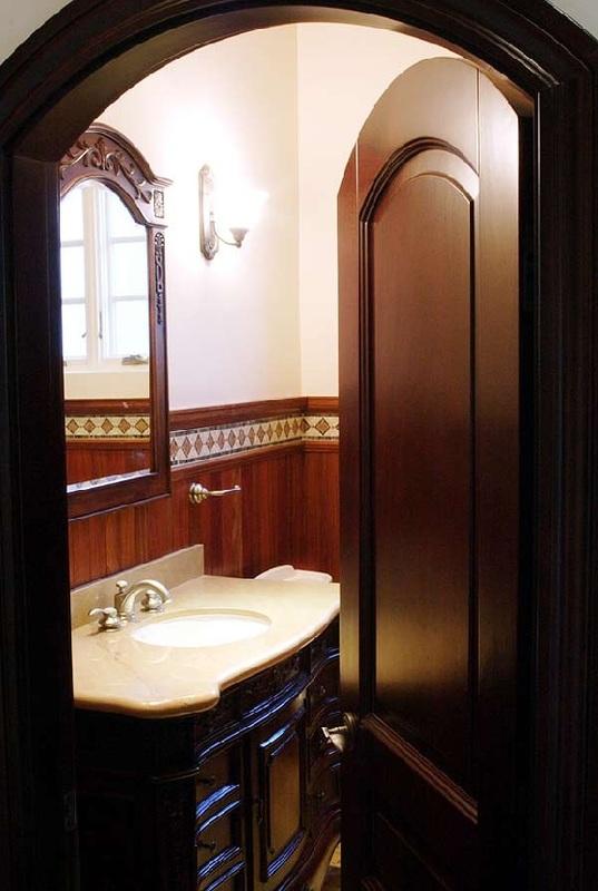 sophisticated bathroom arched doorway