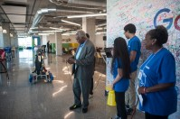 Representative Danny K Davis, gets a try at one of the robots that was on display during the youth technology summit at the Google offices on June 17, 2016.