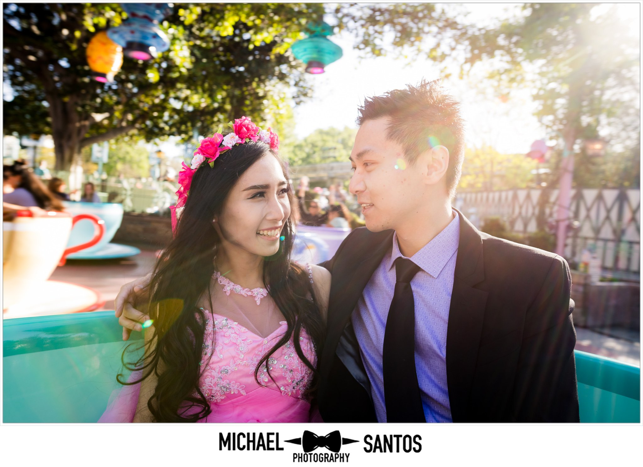 couple on teacups during engagement session at disneyland