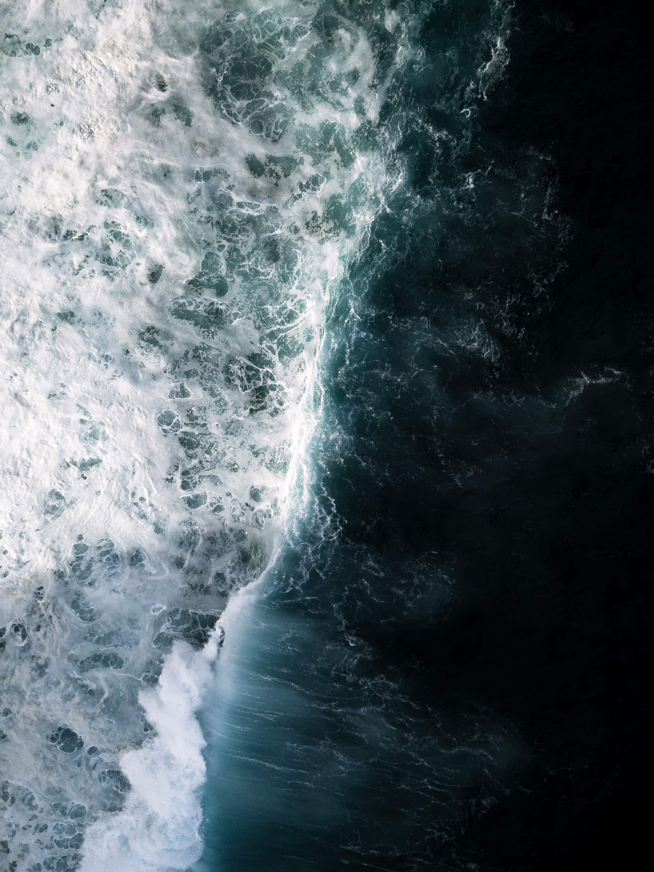 Drone image of crashing waves during sunset out on the Atlantic near Madeira island, Portugal by photographer Michael Schauer
