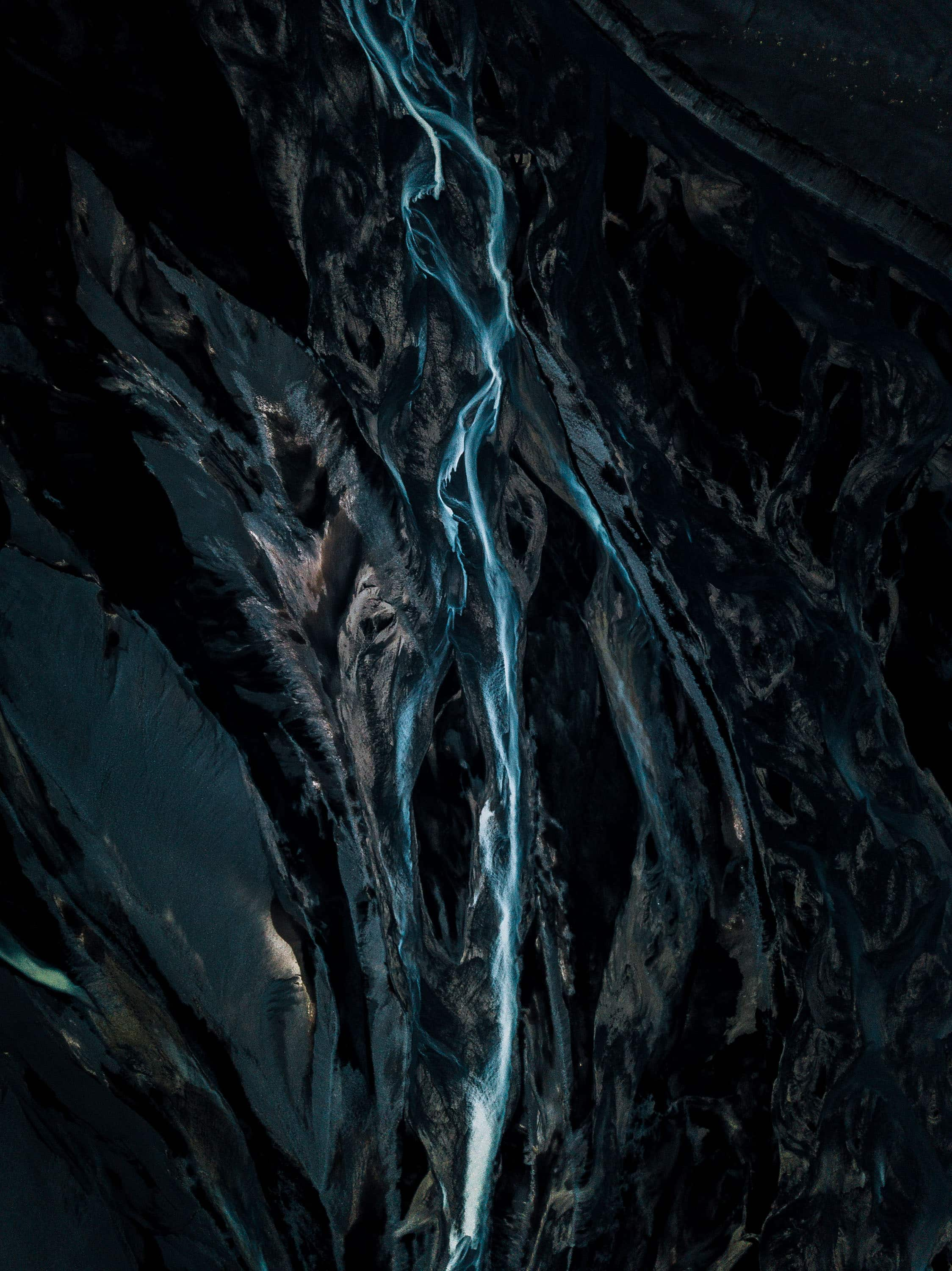Flow shows different states of water be it solid, flowing or as a cloud. Captured in the wild Icelandic landscape often with a drone by photographer Michael Schauer