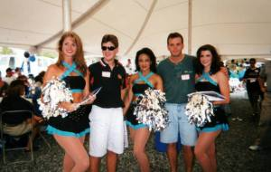 Here's a nice example of a broadcasting perk.  This is Mark and me with the Carolina Panthers cheerleaders.  I'm the good looking one.