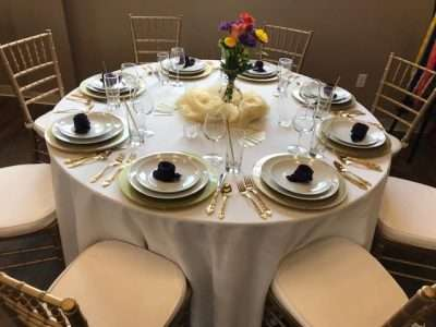 spotlight loose chair covers fabric dining side chairs michaels party rentals wedding pam used white floor length linens with our gold chiavari flatware and charger plates she nova solid eggplant napkins folded