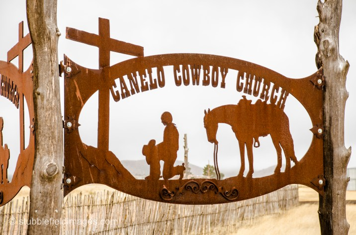 Church sign in metal relief