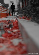 Silhouette of man in background firecracker casings in the foreground