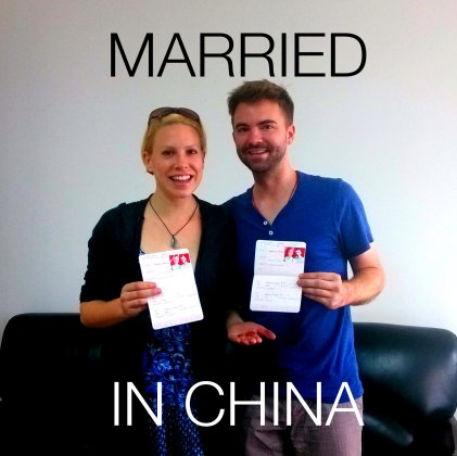 Foreigners in China holding their Chinese marriage license