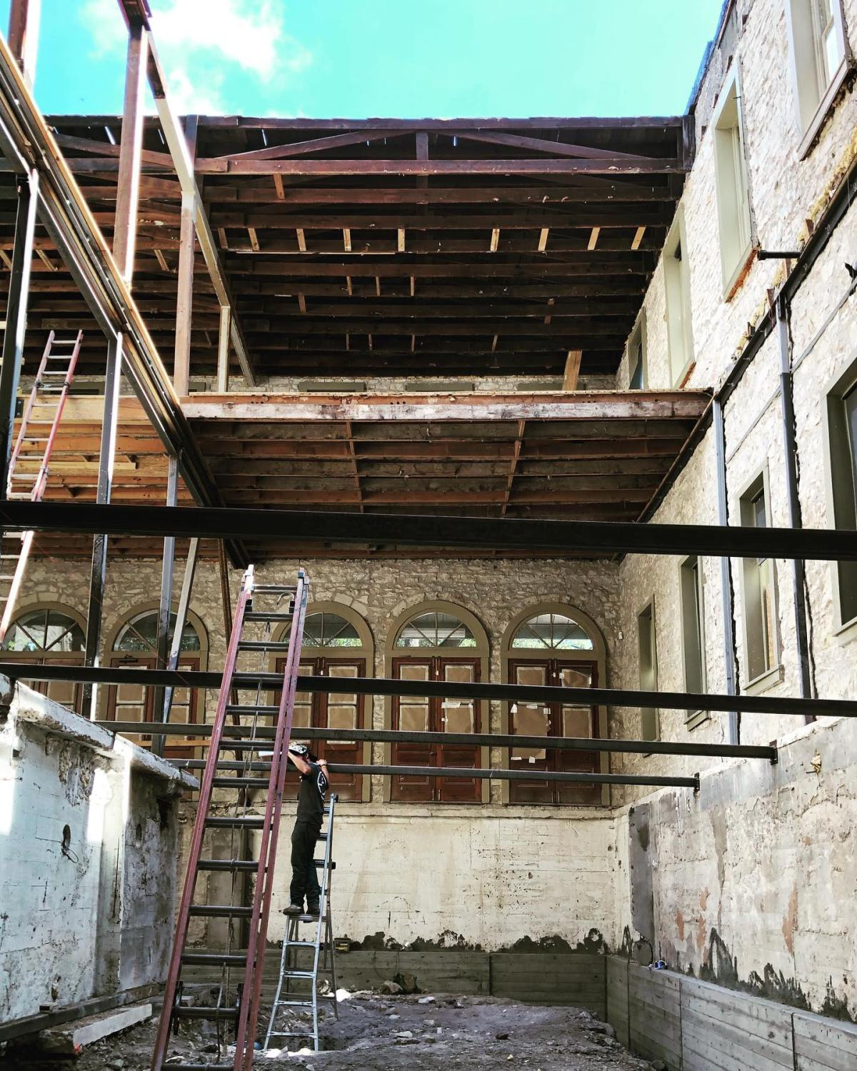 Should me make it a skylight!? Oh wait there's another floor going on top of this 120 yr old building!