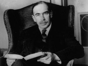 John Maynard Keynes le 31 mai 1929...tenant un livre .