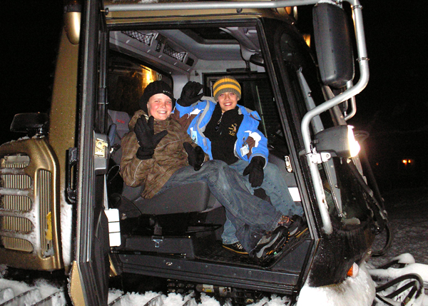 Boys in the snow cat