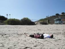 Lying down the Sand of Malbu