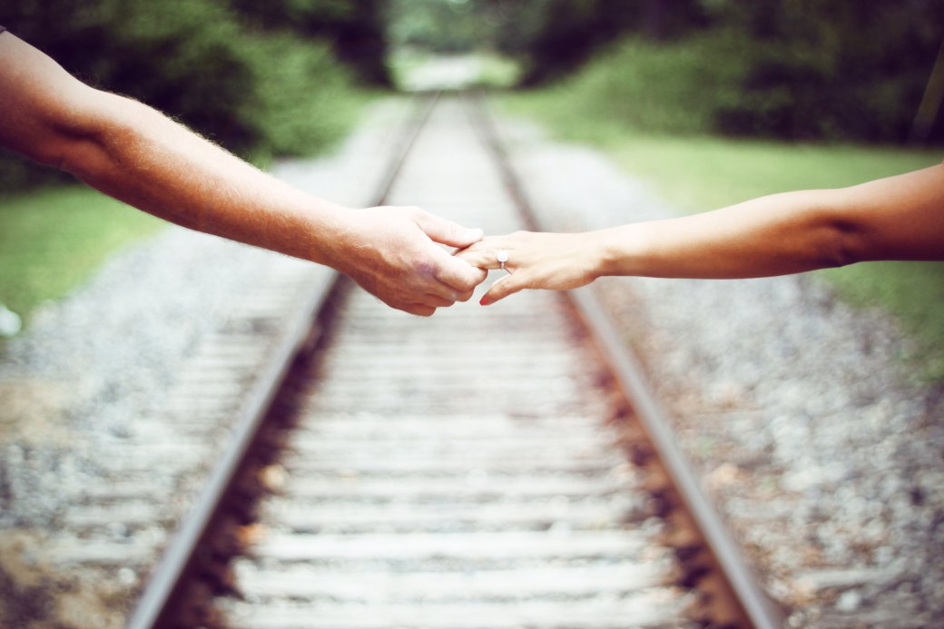 holding hands railroad tracks