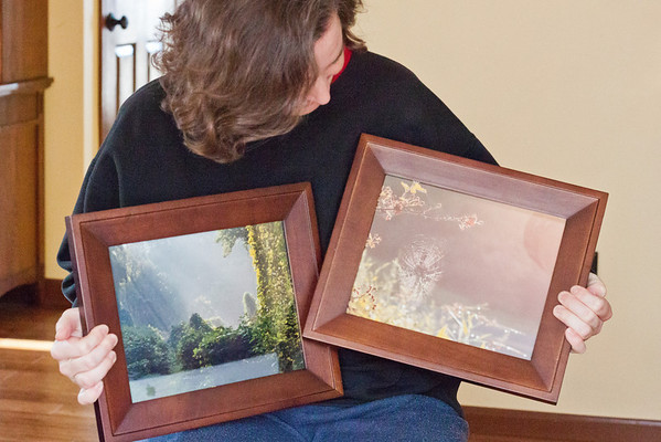 January {self portrait with 2013 goal} I just got these photos of mine from 2012 framed -- first time to do so, other than 4x6 prints in collage frames -- and I intend to print and frame some more of my pictures in 2013!  f/5  1/125sec  ISO6400  I also want to improve my self-portraiture skills this year.  And my processing skills!