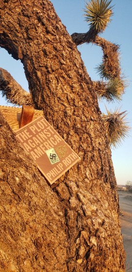 The Plot Against America book cover on a Joshua Tree background.