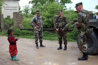 bosnian girl chats with soldiers