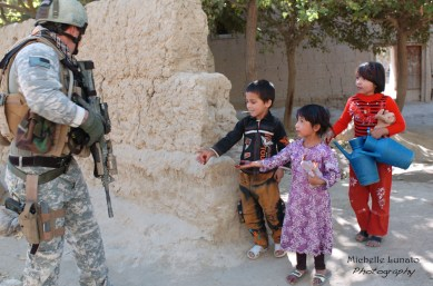 As we walked, the children would run out of the houses. Soldiers always seem to carry candy to hand out to them when they pass through.