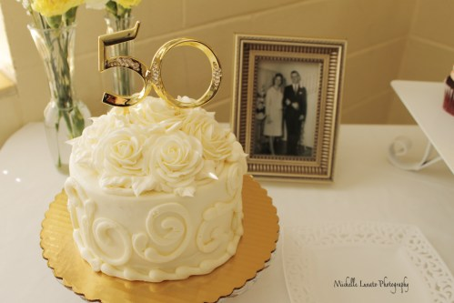 Focus is the cake, yet you see the couple's pictures.