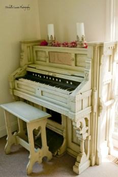 A closer look at the piano seen through the door.