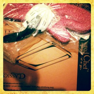 Pampered Chef stoneware pan, Pampered Chef Oven Mitt, and Pampered Chef Pizza Cutter