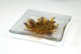 Chrysanthemum design in black, underpainted with frit on a clear platter