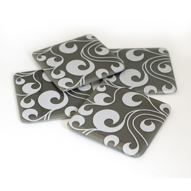 Swirls in white, on grey coaster set