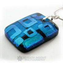 Etched, layered, and fused dichroic glass pendant by Michelle Prosek