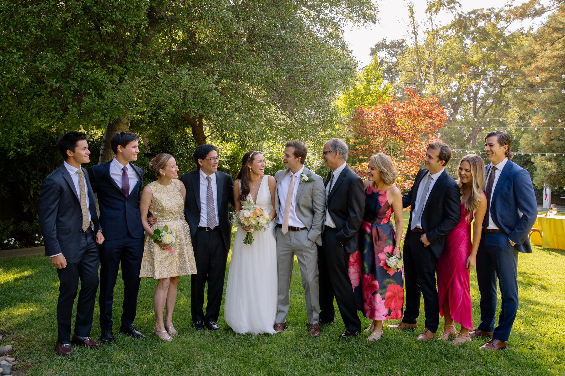 casual family wedding portait in their backyard