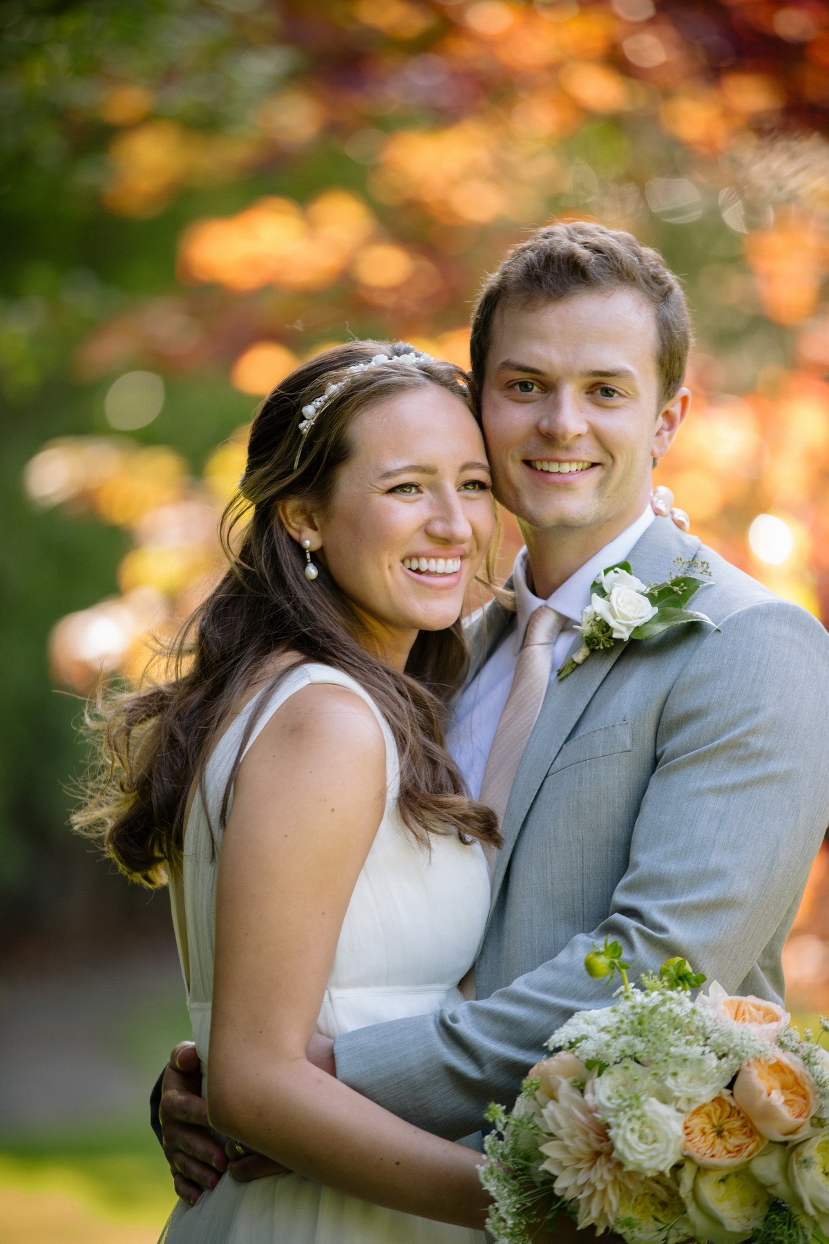 bride and groom with fall foliage