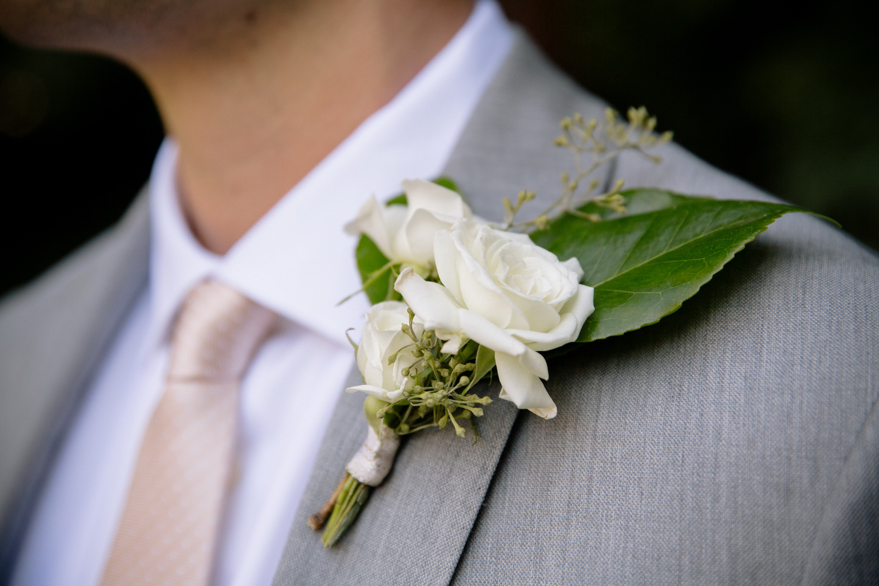 white rose groom boutonniere