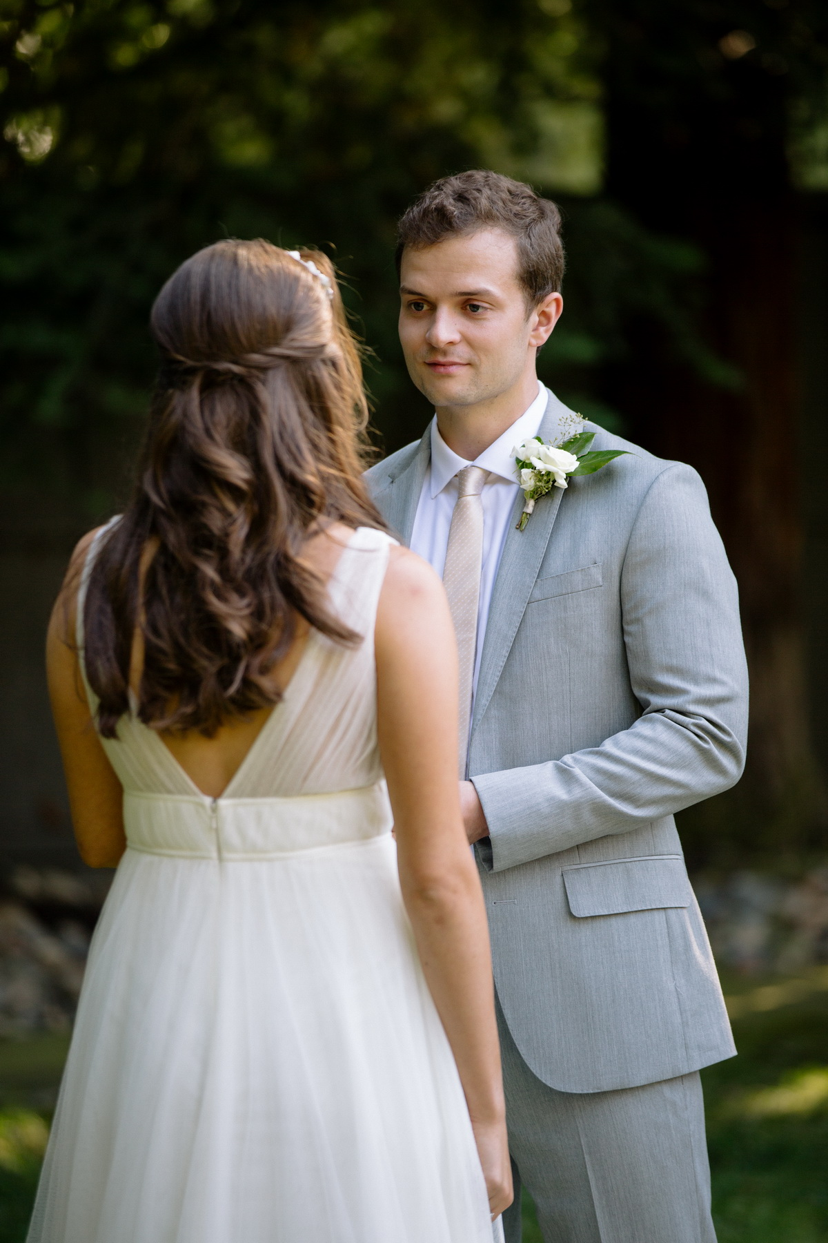 grooms face as he recites his vows