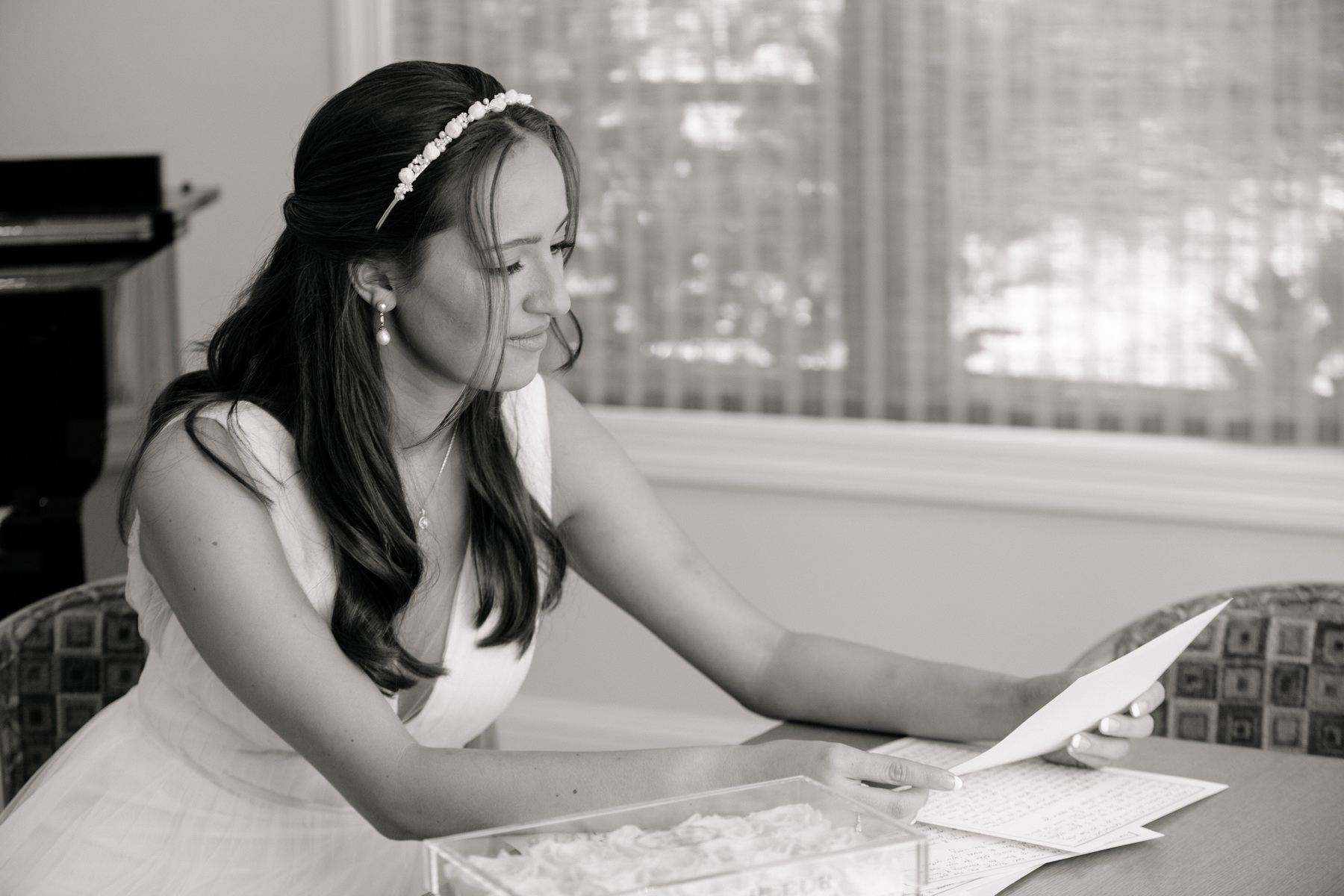 bride reading a note from her fiance