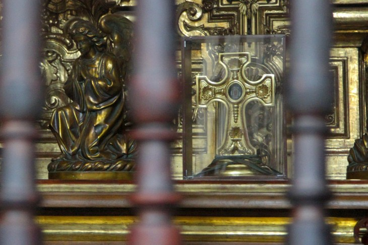 cross behind bars