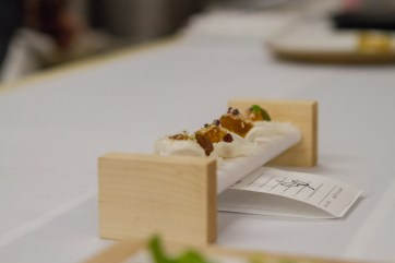 Crispy rice cups with lamb gelee, awaiting pickup.