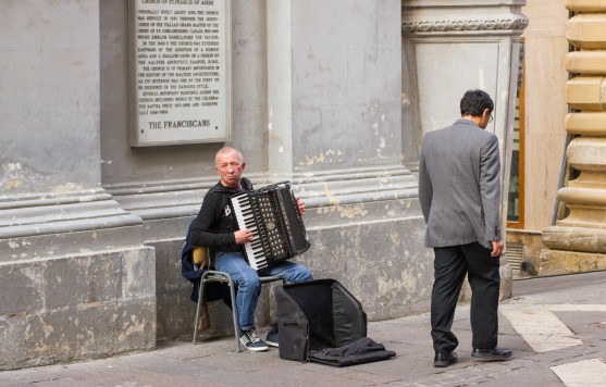 no one ever stops for the accordion player