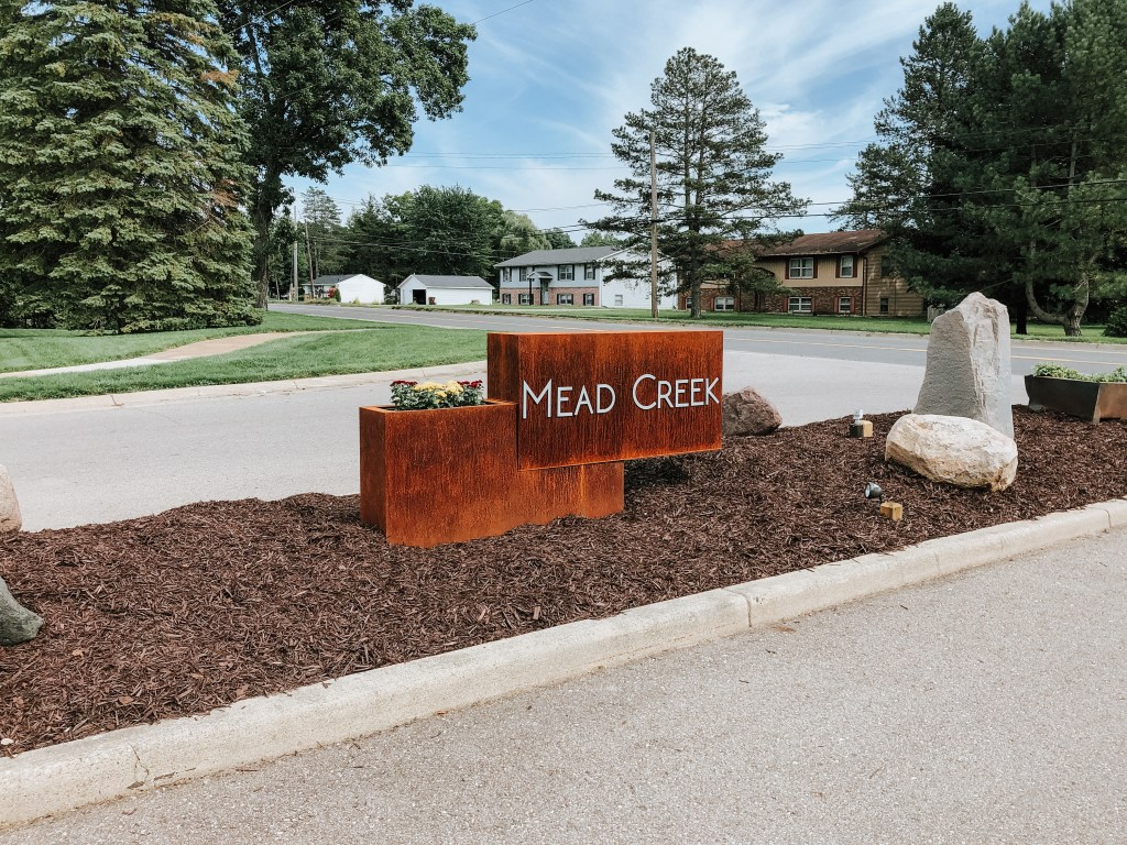 New subdivision sign created for Mead Creek in Bath, Michigan. This custom sign is made from Stainless steel and Corten.
