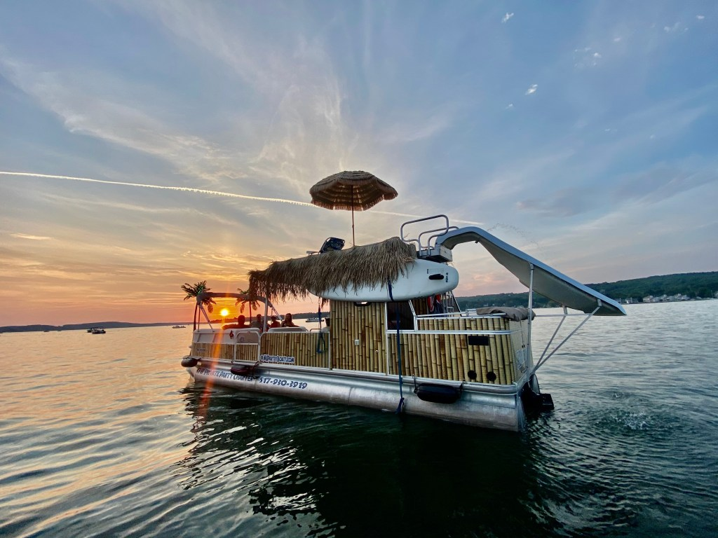 Custom welding and fabrication to connect this pool slide to this party boat on Torch Lake