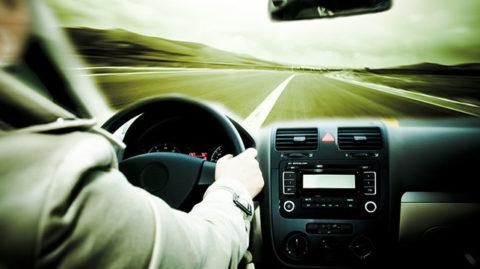 person speeding on the freeway