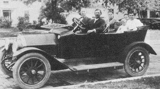 This photo is of a 1913 Model R. Note the left hand drive, nickel radiator & headlight bezels, running board tool box. Cannot see any pin striping.  Car is from J. H. Kohorst photos in St. John's Church, Arcadia IOWA.