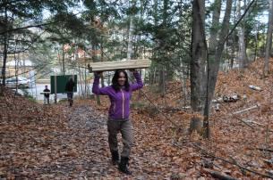 Volunteer Nicole Mathiasz helps build a boardwalk at Twin Waterfalls Plant Preserve.