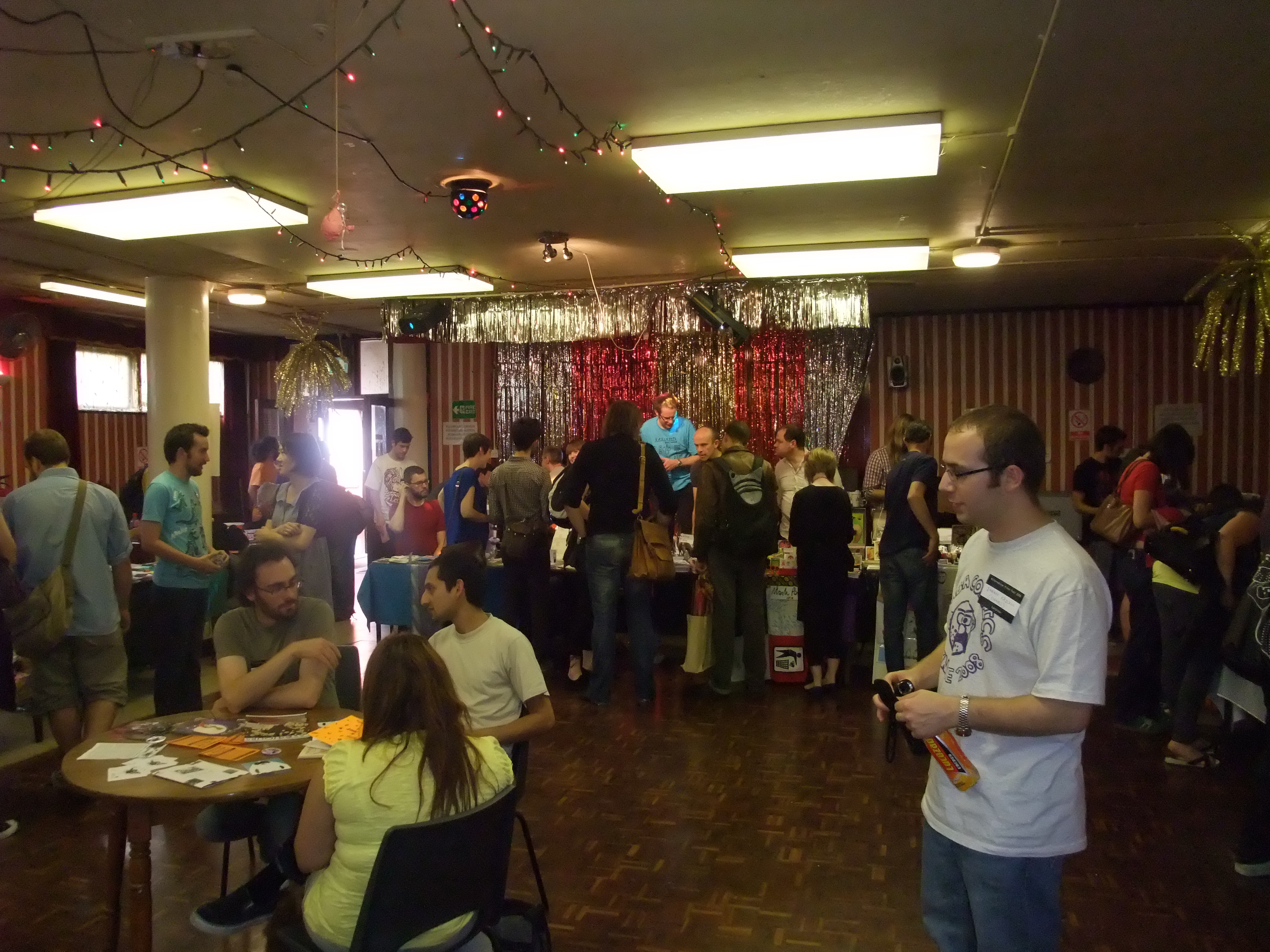 Good times...loads of people gather around zine tables