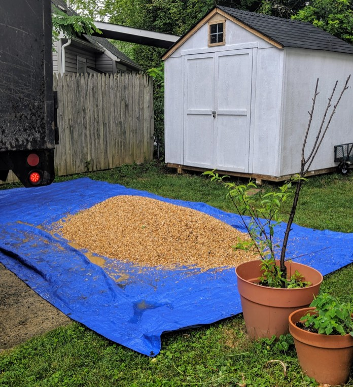 One ton of pea gravel on a blue tarp.