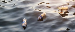 Plastic garbage in the river on sunset, pollution and environment concept