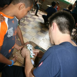 MSOE and Global Brigades show children in Honduras how to use the Foldscope
