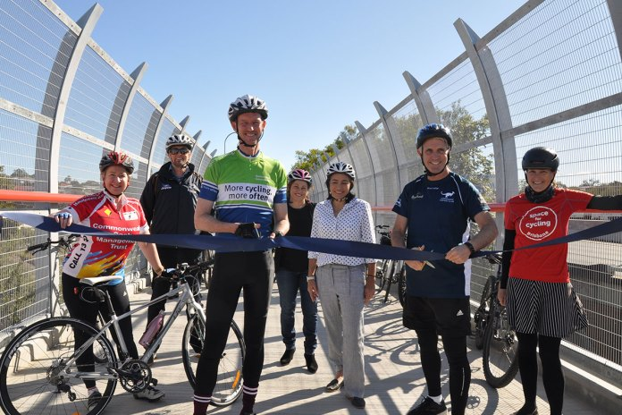 Queensland's Minister for Transport and Main Roads, Mark Bailey (centre, wearing green and blue jersey).